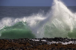 Waves splashing on basalt rocks at Ocean beach Bunbury  Western Australia Stock Image