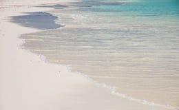 Waves splashing on a beach. Waves splashing on a white sand beach of an maldivian island Royalty Free Stock Images