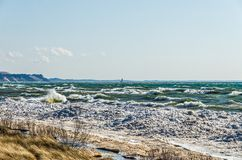 Beach, Ice, Waves, and a Lighthouse Stock Images