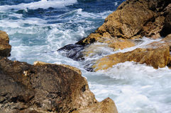 Waves splashing into rocks Stock Image