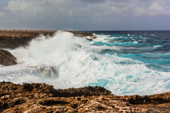 Waves splashing on rocks Bonaire Royalty Free Stock Image