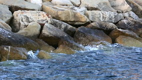 Waves Splashing on Rocks. Waves Hitting The Rocky Sea Shore stock video footage
