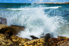 Waves splashing rocks Stock Photos