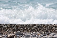 Waves splashing on rocky beach royalty free stock images