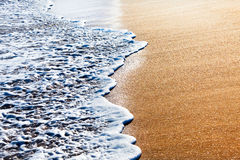 Waves splashing on sandy beach Royalty Free Stock Photography