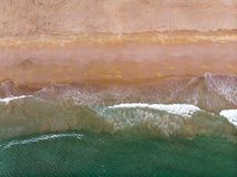 Waves splashing the sea shore aerial view royalty free stock image