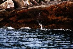 Waves. Splashing on the stone Royalty Free Stock Images