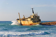 Waves splashing on the sunken ship royalty free stock photo