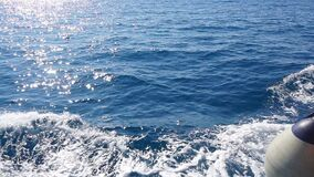 Waves at the stern of the ship sailing on the sea. Slow motion.