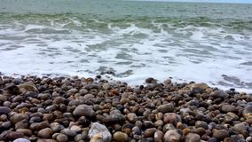 Waves on a stone beach.  stock footage