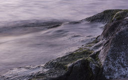 Waves and stones. Royalty Free Stock Photo