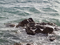 Waves and stones Royalty Free Stock Image