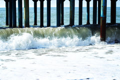 Waves after storm under pier Stock Photography