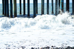 Waves after storm under pier Royalty Free Stock Photography