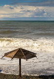 Waves and Sun Parasol Royalty Free Stock Images