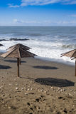 Waves and Sun Parasols Royalty Free Stock Photos