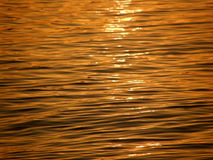 Waves and sun reflection on sea Stock Images