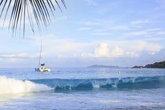 Waves at sunrise on the beach Anse Lazio Stock Photos