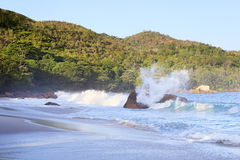 Waves at sunrise on the beach Anse Lazio Stock Photo