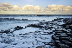 Waves at sunrise at the famous Giant's Causeway Royalty Free Stock Photo