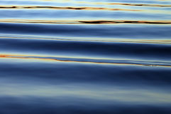 Waves at sunset. Water abstraction - surreal sunset on lake waves Stock Image