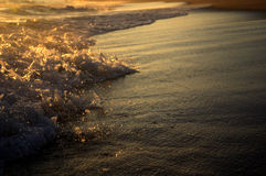 Waves at Sunset. Waves breaking on Nantucket with water droplets spewing out stock image