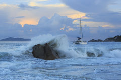 Waves at sunset on the beach of Anse Lazio Royalty Free Stock Photo