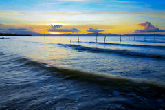 Waves and sunset at Borneo, Sabah, Malaysia Royalty Free Stock Images