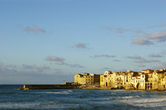 Waves at sunset in Cefalu. Sicilian town Cefalu pennisula and pier sea waves and beach stock photos