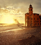 Waves at sunset on the seafront Camogli Stock Images
