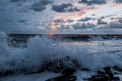 Waves at sunset. Strong waves at sunset royalty free stock images