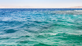Waves on surface of Gulf of Aqaba on Red Sea. Travel to Middle East country Kingdom of Jordan - waves on surface of Gulf of Aqaba on Red Sea in winter morning Stock Images