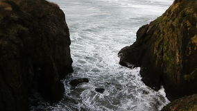 Waves Surging In Between Two Cliffs Depoe Bay Oregon. Waves Coming In Between Two Cliffs Depoe Bay Oregon stock video