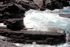 Waves that swell on the rocky n. Waves that swell on the rocky shores royalty free stock photography