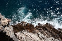 Waves that swell on the rocky x. Waves that swell on the rocky shores stock images