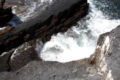 Waves that swell on the rocky a. Waves that swell on the rocky shores Stock Photos