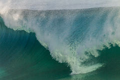 Waves Swells Cyclone. Ocean wave wall crashing onto shallows from cyclone swells Stock Images