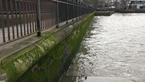 The waves of the Thames. River embankment. stock footage