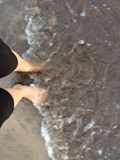 Waves touching the feet of me.. Stock Image