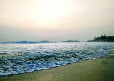 Waves touching the shore, scene from Kovalam beach. Eve& x27;s beach also known as Hawa beach. Waves touching shore, scene kovalam beach . eve& x27;s beach   as stock image