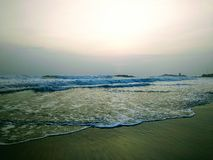 Waves touching the shore, scene from Kovalam beach. Eve's beach also known as Hawa beach. stock photo