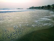 Waves touching the shore, scene from Kovalam beach. Eve& x27;s beach also known as Hawa beach. royalty free stock image