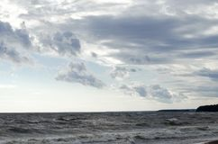 Waves under the clouds royalty free stock images