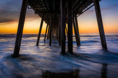 Waves under the fishing pier at sunset, in Imperial Beach, Calif. Ornia Royalty Free Stock Image