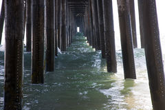 Waves Under A Pier Stock Photography