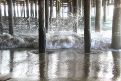 Waves under Santa Monica pier California Stock Photography
