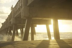 Waves under wooden pier Royalty Free Stock Photos