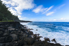 Waves and volcanic rocks in the south coast of Reunion Island Royalty Free Stock Photo