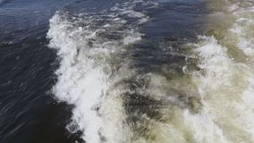 Waves and wakes from motor boats. The sound of water and motor. Footage clip 4K, Ultra HD