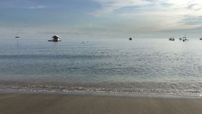 Waves of the warm sea run on the sandy beach early in the morning, Pemuteran Bali.  stock footage